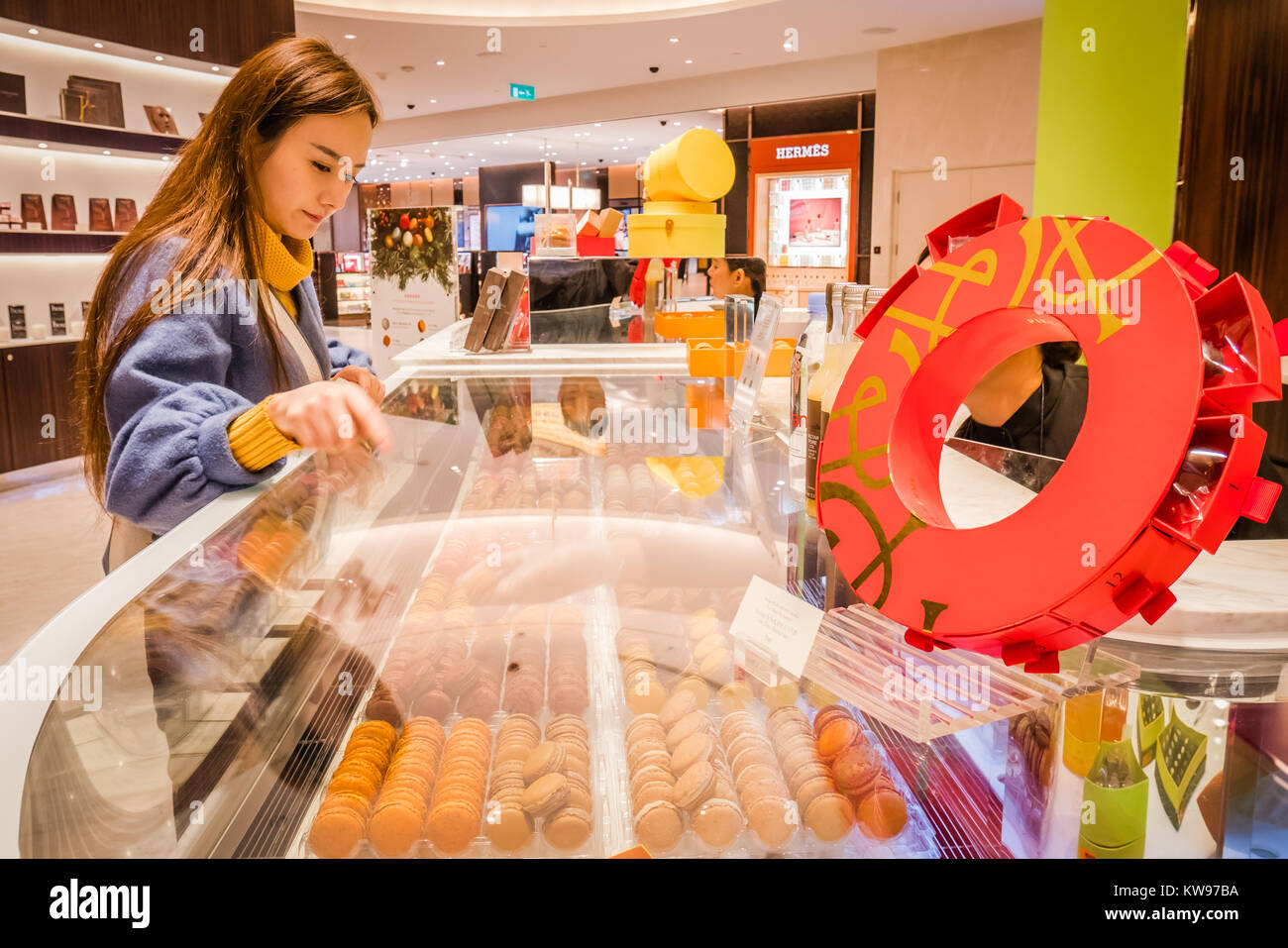chinese customer ordering macarons at pierre herme shop in macau - Stock Image