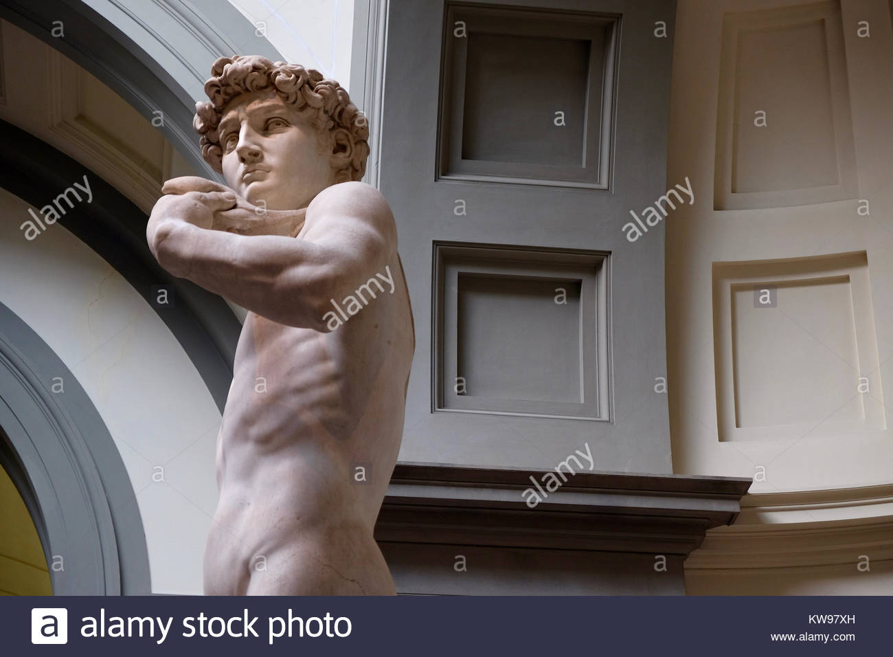 The David is one of the most classic pieces of art in the world and stands here with the look of planning. Stock Photo