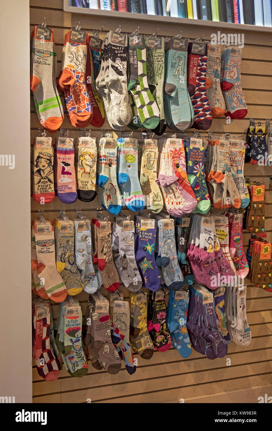 A selection of statement socks for girls and women for sale at Newbury Comics in the Roosevelt Field mall in Garden - Stock Image