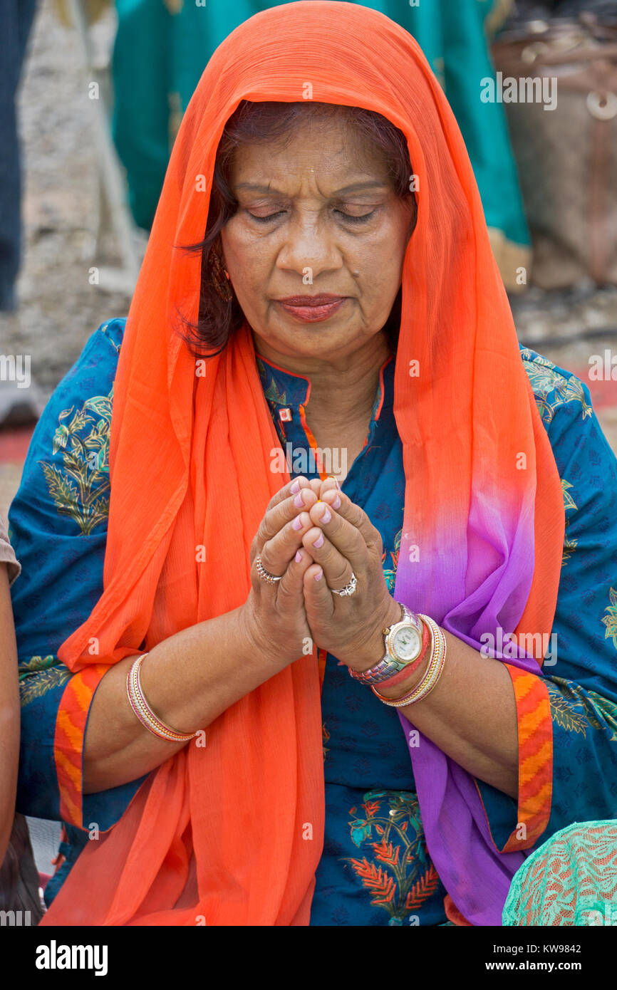Portrait of a Guyanese Hindu woman in solemn prayer at the Lakshmi Hawan services at the Diwali Motorcade in Richmond - Stock Image