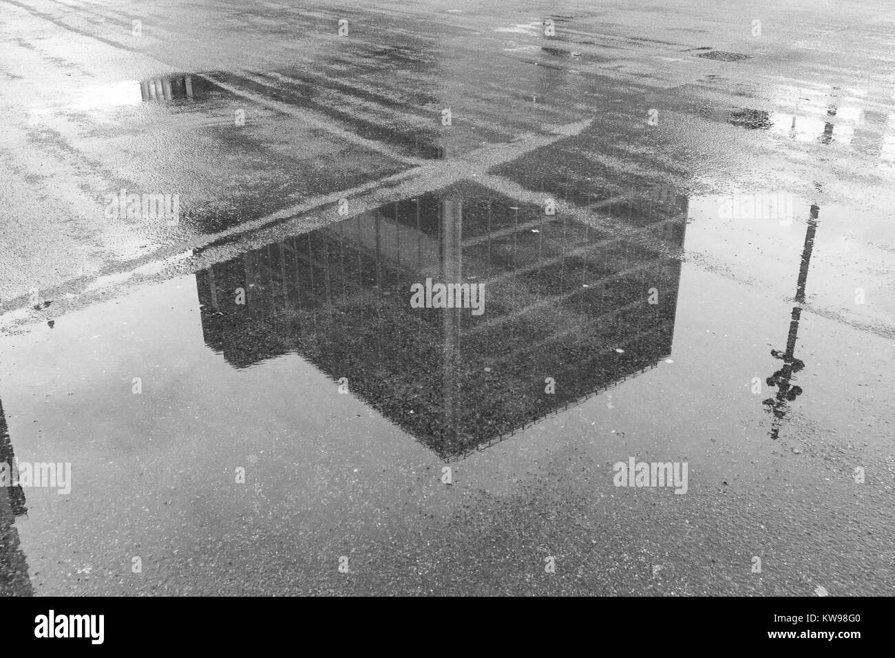 Reflection of new office buildings in puddles in Stratford, London. - Stock Image