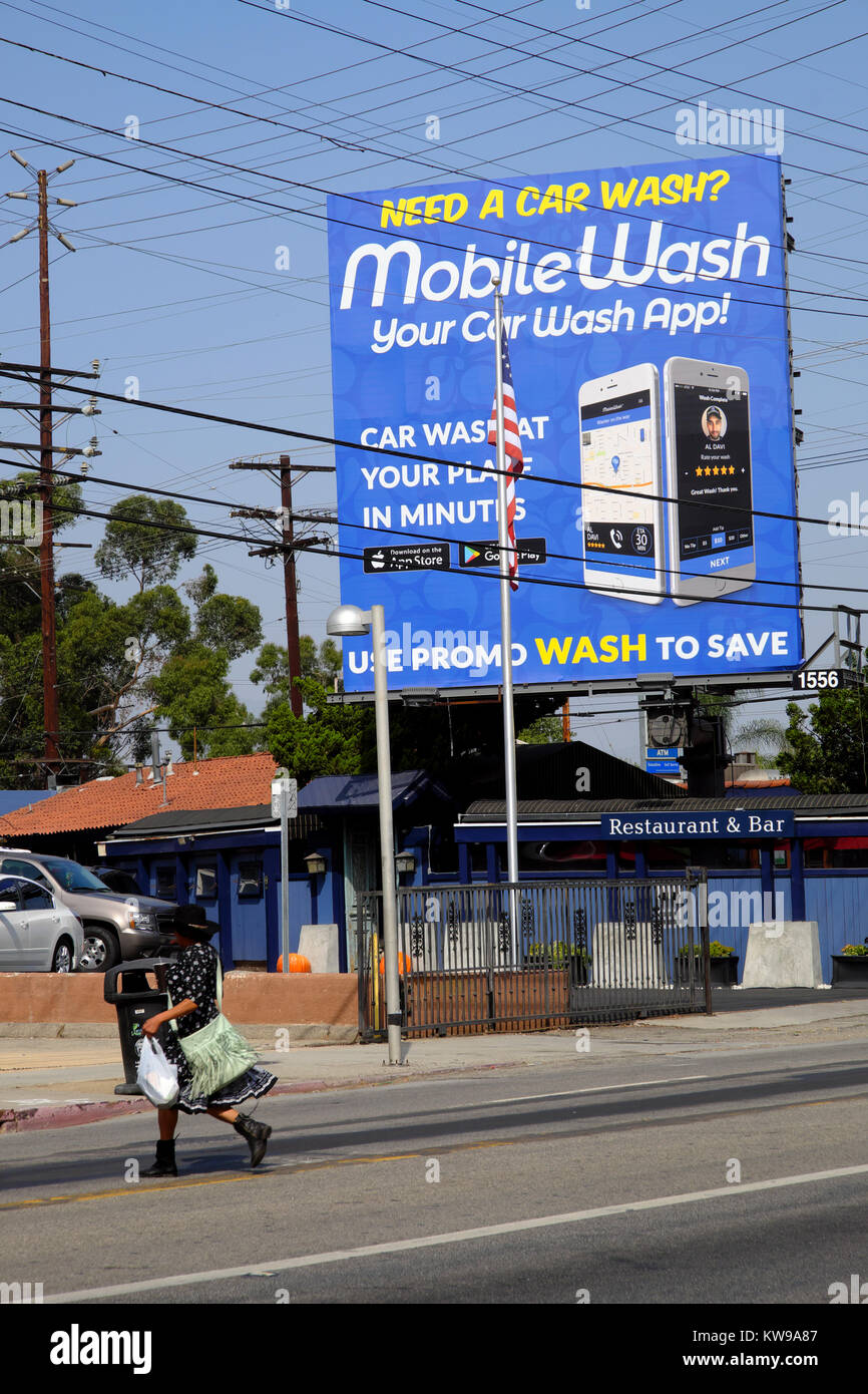 Mobile Wash Car Wash App Advert With Cables And Pylons Outside A Car