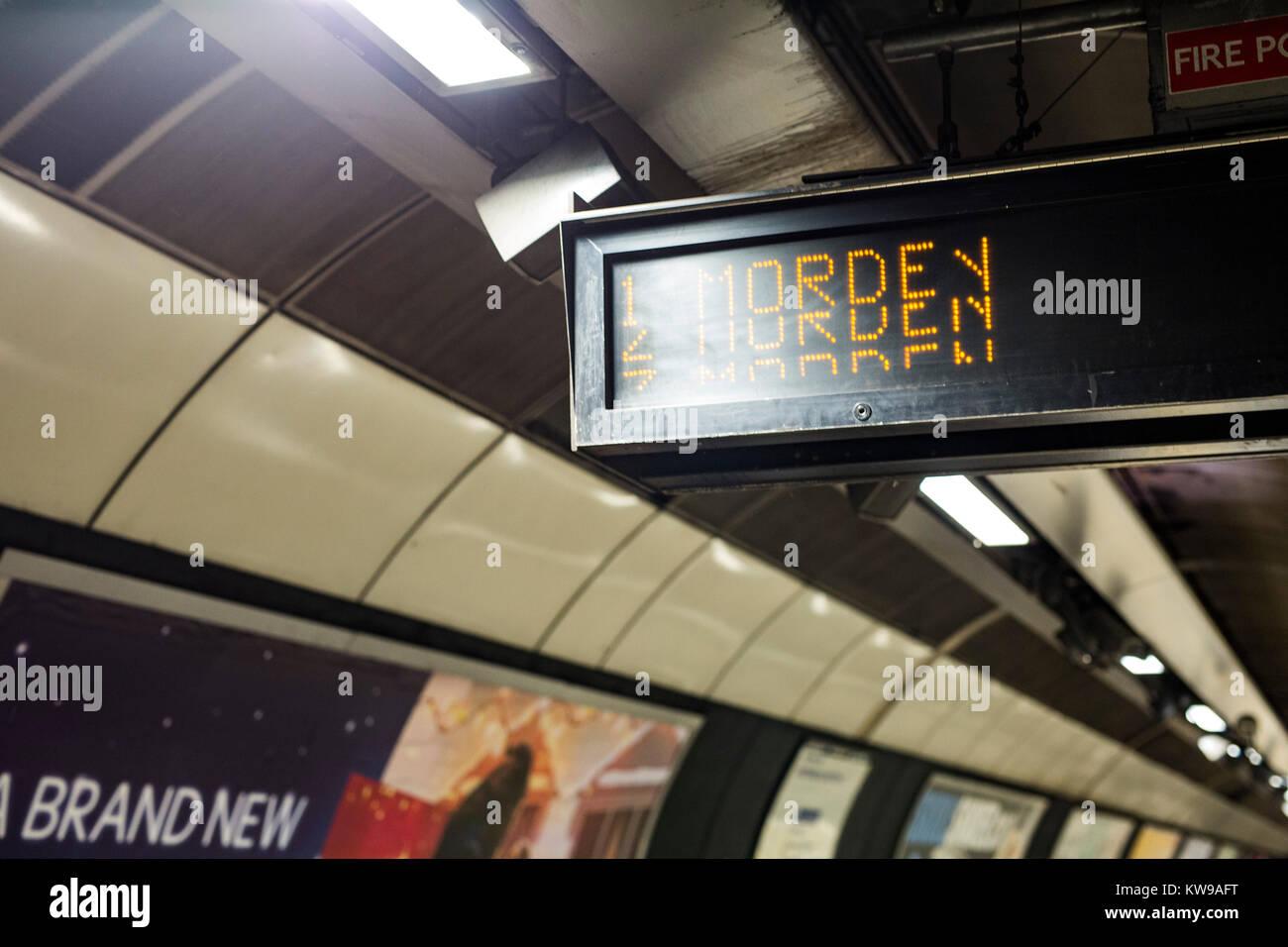Information boards at southbound Northern line platform at London Bridge station displaying 'Morden' as - Stock Image