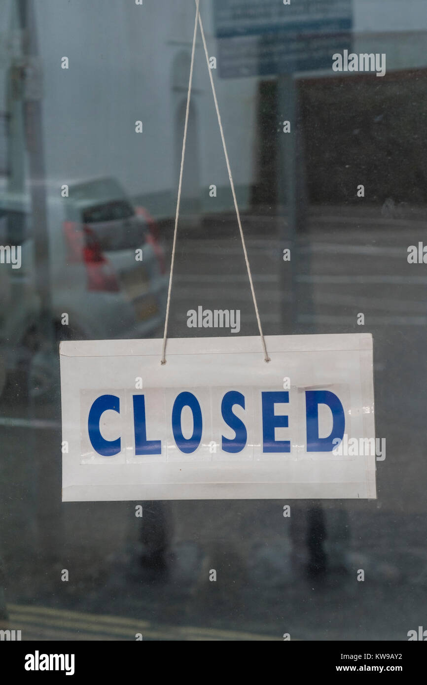 Death of High Street. Shop 'Closed' sign - business had 'gone out of business'. For recession, retail casualties, Stock Photo