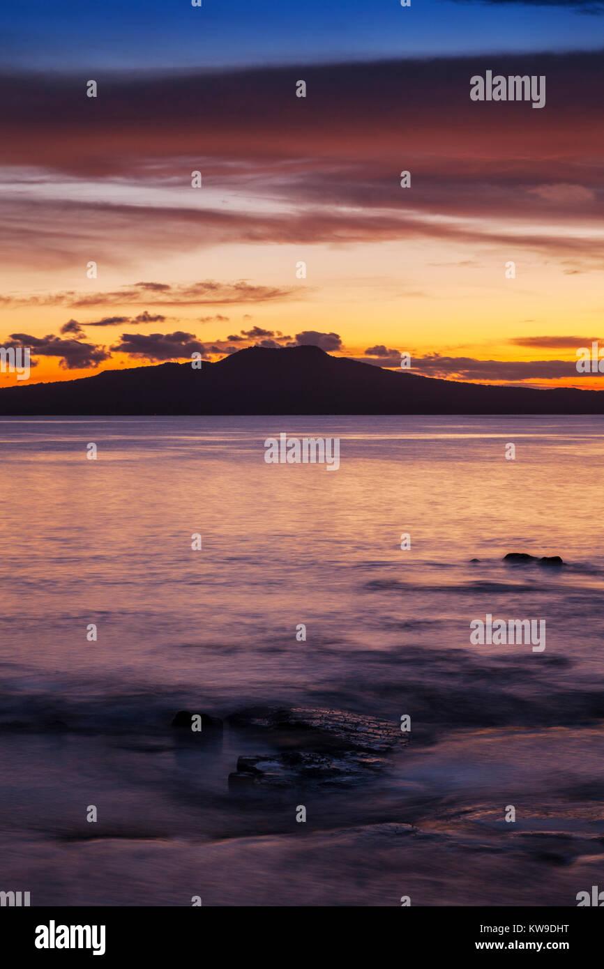 Rangitoto Island at sunrise, Auckland, New Zealand. - Stock Image