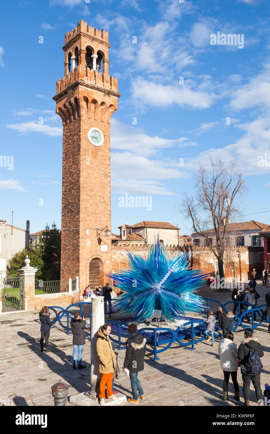Campo San Stefano the historic Clock Tower and the Comet Glass Star, Murano, Venice, Italy with tourists in winter - Stock Image