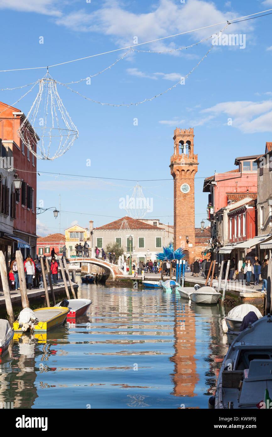 Murano, Venice, Veneto, italy, view along Canal Vetrai  of the Clock Tower in Campo San Stephano reflected in the Stock Photo
