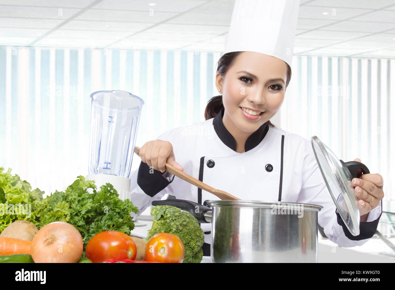 female chef Cooking in the kitchen. Healthy Food Diet. Prepare Food ...