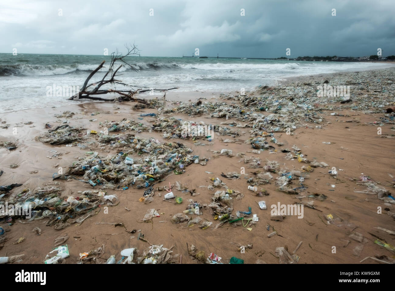 Bali, Indonesia - December 19, 2017: Garbage on beach, environmental pollution in Bali Indonesia. Storm is coming - Stock Image