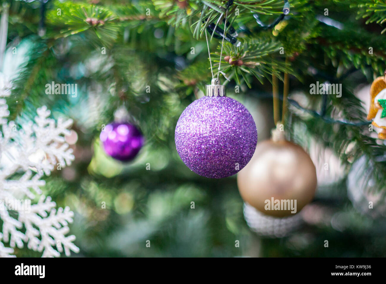 Closeup Christmas Tree Baubles Decorations Blurred Purple Gold Stock Photo Alamy