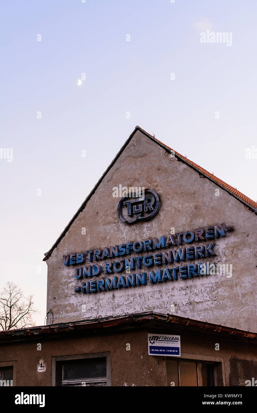 "old factory from GDR times sign ""VEB Transformatoren- und Röntgenwerk Hermann Matern, TuR"" Stock Photo"