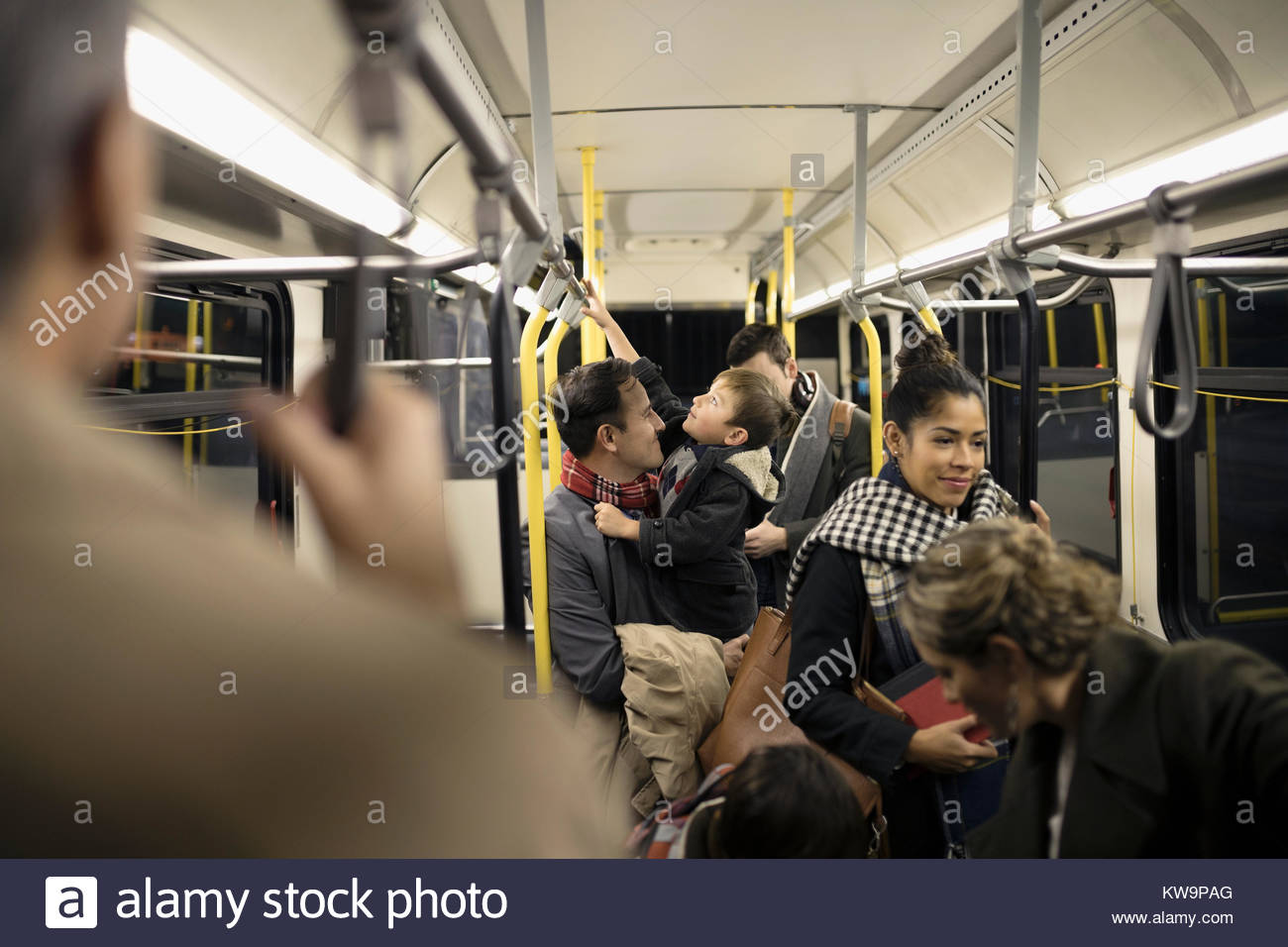 Commuters riding bus - Stock Image