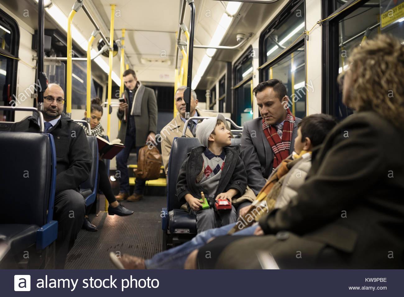 Latino family riding bus - Stock Image