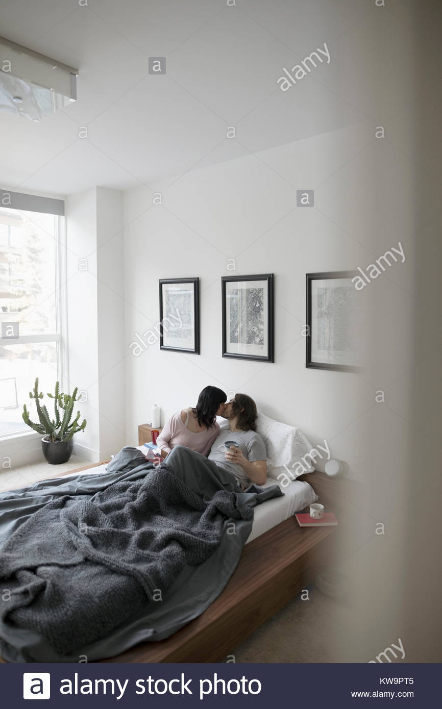 kissing couples romantic in bed romantic couple kissing in bed stock photos romantic 8061