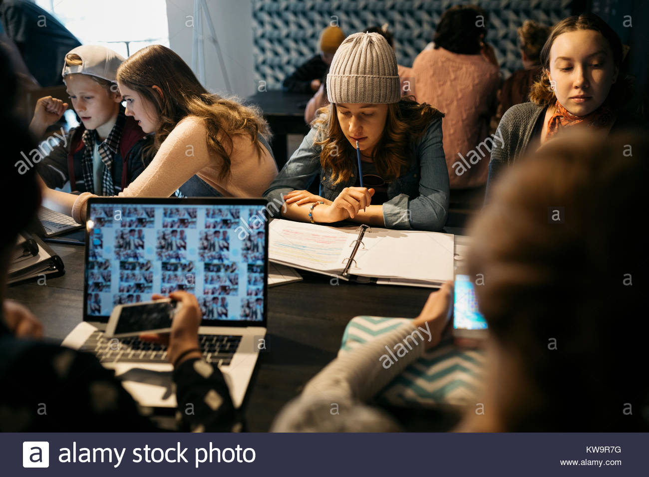 Focused high school girl student studying notes in cafe - Stock Image