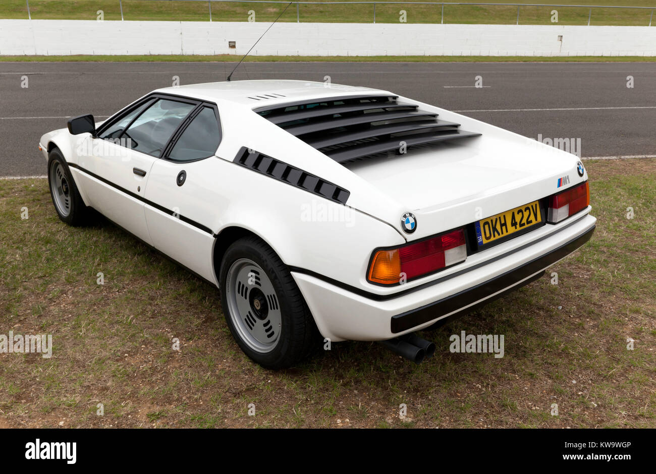 Three-quarter rear view of a  1980, BMW E26 M1 on display  at the BMW Car Club of Great Britain Ltd zone of the - Stock Image