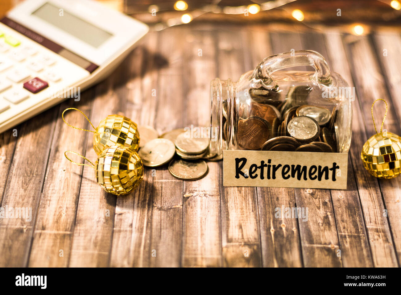 Retirement money jar savings motivational concept on wooden board - Stock Image