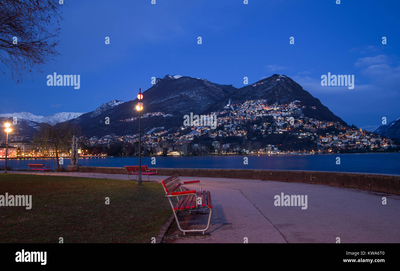 healthy walk early in the morning on the lakefront,to start the day in the best way. Lugano, Switzerland. Stock Photo
