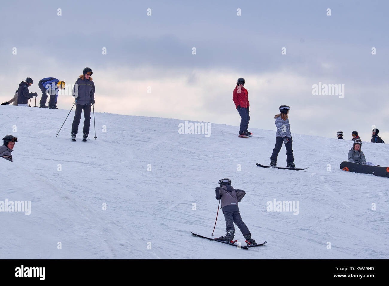WINTERBERG, GERMANY - FEBRUARY 16, 2017: Group of young skiers on skis and snowboards at Ski Carousel Winterberg - Stock Image