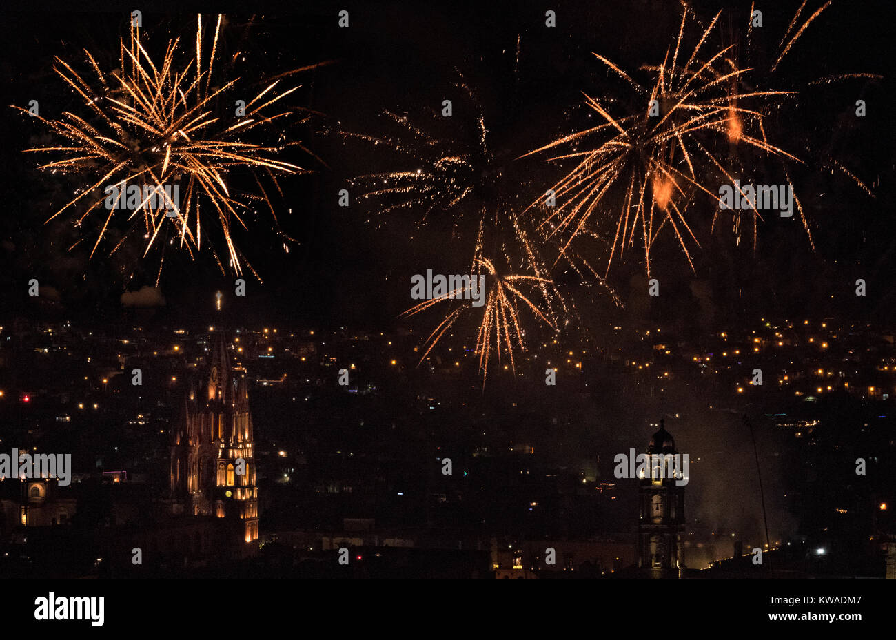 Fireworks explode over the the colonial center on the stoke of midnight celebrating the New Year January 1, 2018 - Stock Image