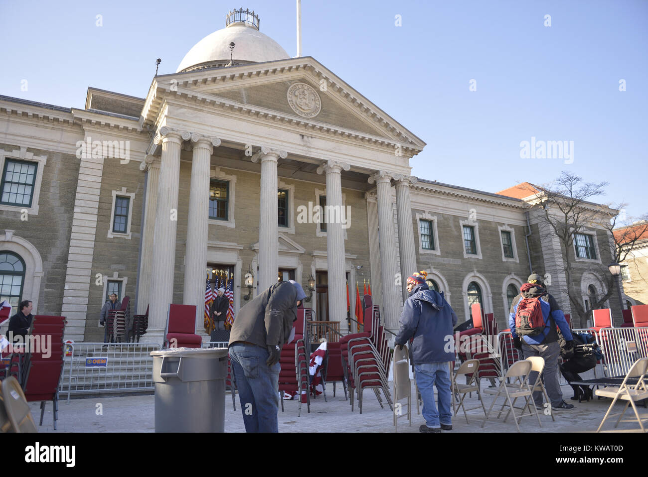Mineola, New York, USA. 1st Jan, 2018. Workers remove chairs, flags, bunting from location the swearing-in ceremony - Stock Image