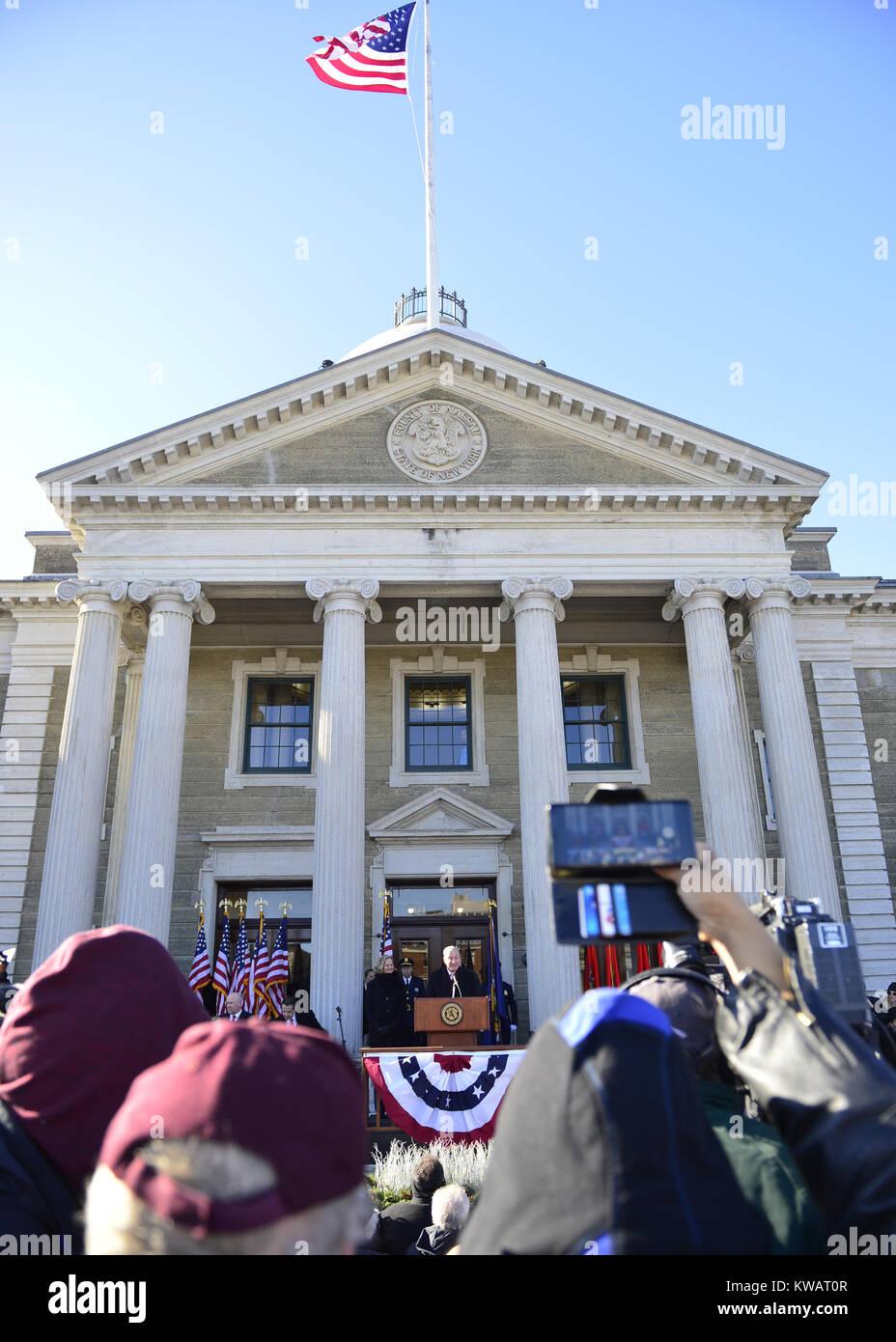 Mineola, New York, USA. 1st Jan, 2018. Speaking at podium is U.S. Senator CHUCK SCHUMER of New York, and left of - Stock Image