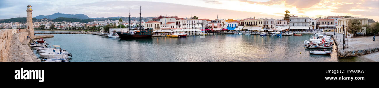 Evening with boats and restaurants on the Venetian harbor, Rethymno, Rethimnon, Panorama, Crete, Greece, Europe, - Stock Image