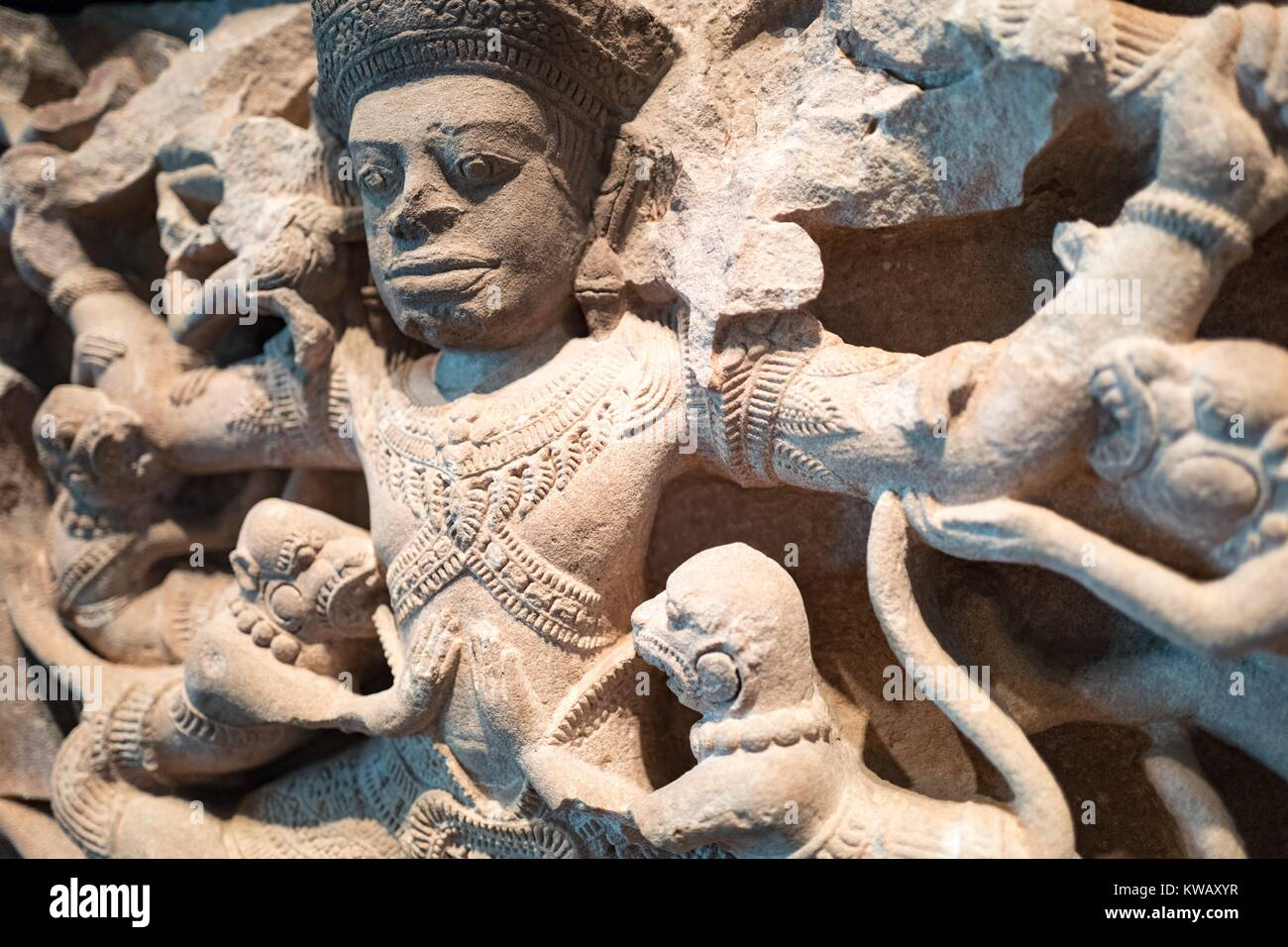 Detail view from the Indian carved stone work Kumbhakarna Battles the Monkeys, showing a scene from the epic Ramayana - Stock Image
