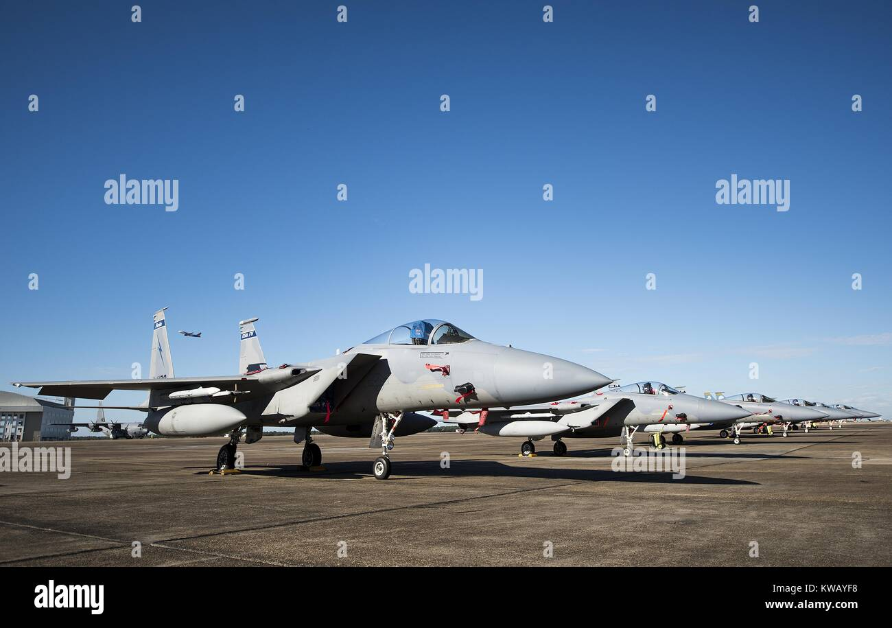 A row of 125th Fighter Wing F-15s from Jacksonville Fla. stack the Eglin Air Force Base flightline Oct. 7, October 7, 2016. The Air National Guard unit sent 15 aircraft to ride out Hurricane Matthew here. The Marine Fighter Attack Squadron-501 sent 10 F-35Bs from South Carolina to the base for sheltering as well. The 96th Aircraft Maintenance Squadron's F-15 unit and the Navy's Strike Fighter Squadron 101 provided support to the transient aircraft. (U.S. Air Force photo/Samuel King Jr.). Stock Photo