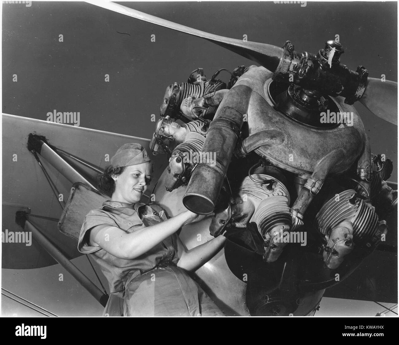 A top-notch mechanic, Mary Josephine Farley expertly rebuilds airplane engines; although she is only twenty years - Stock Image