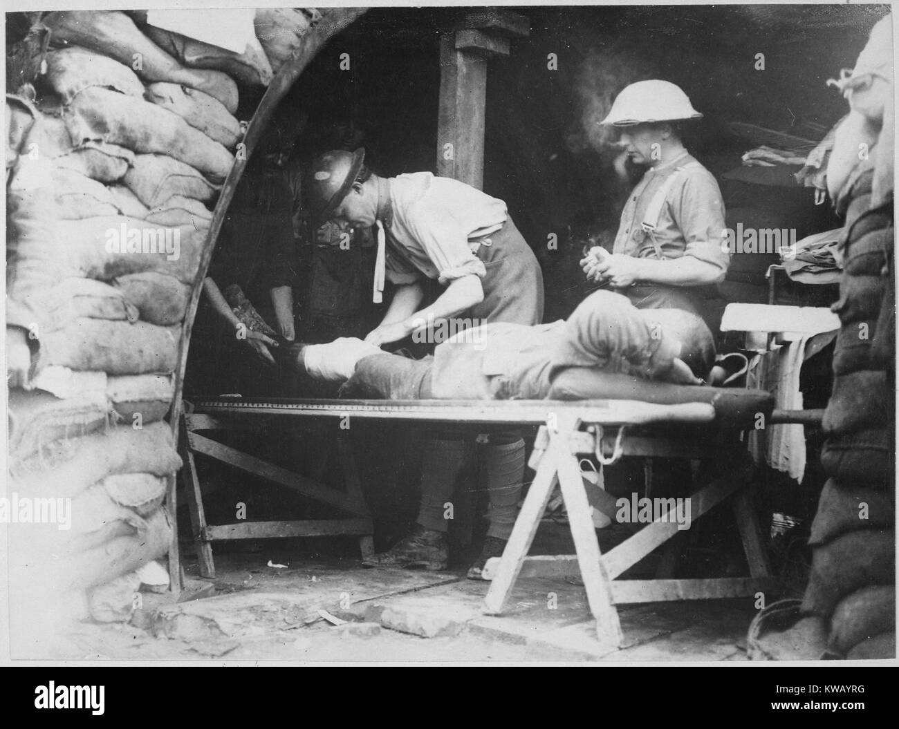 Scottish territorials being examined by two medical staff on a table in a dressing station inside a British bunker - Stock Image