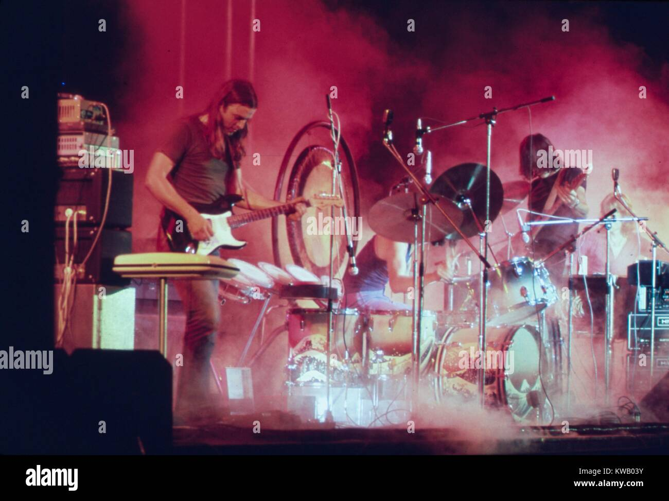 Pink floyd playing on the stage surrounded with a smoke and stock pink floyd playing on the stage surrounded with a smoke and illuminated with a red stage lights during the concert at merriweather post pavilion columbia aloadofball Images