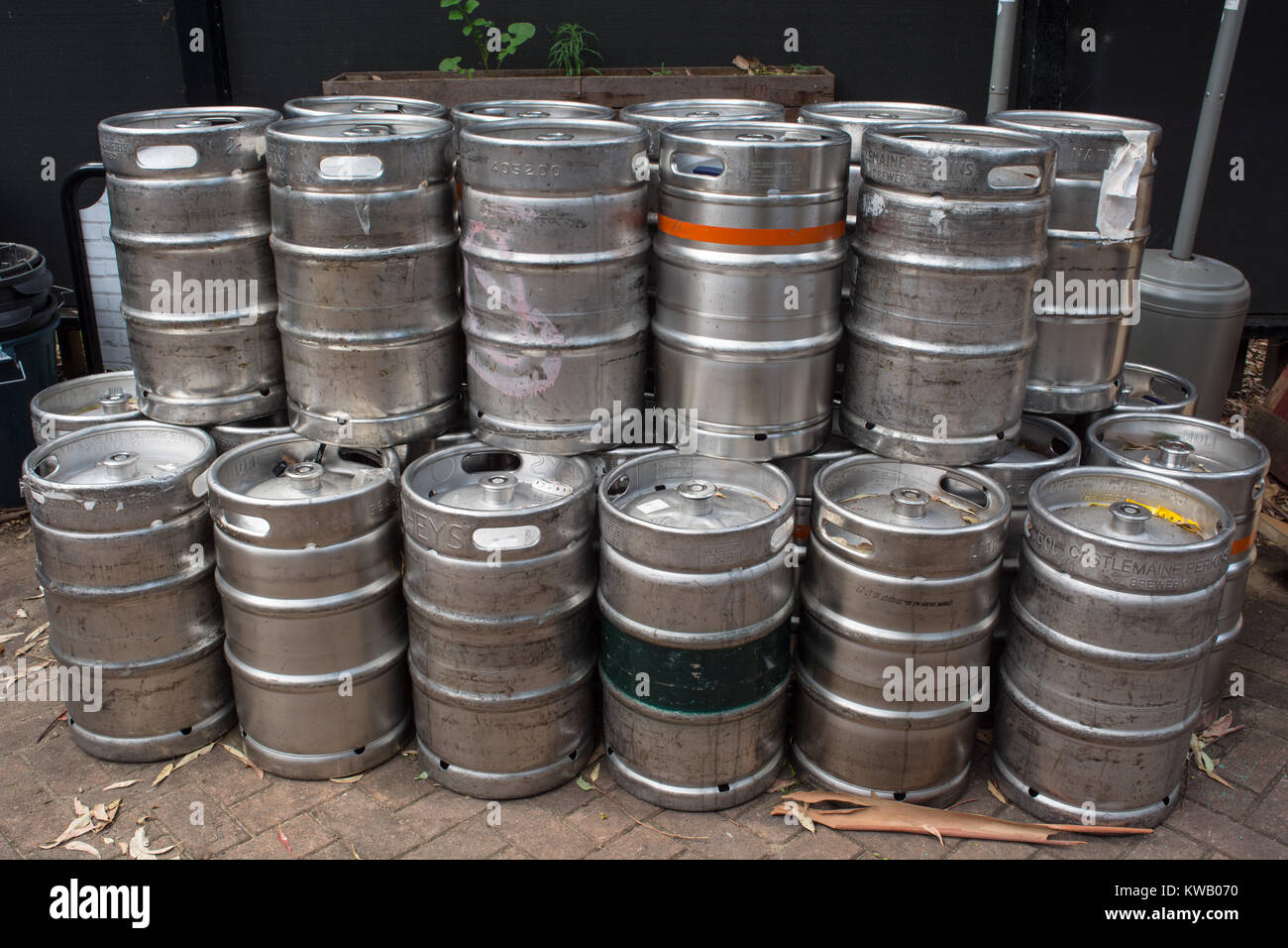 A stack of beer kegs behind a Pub - Stock Image