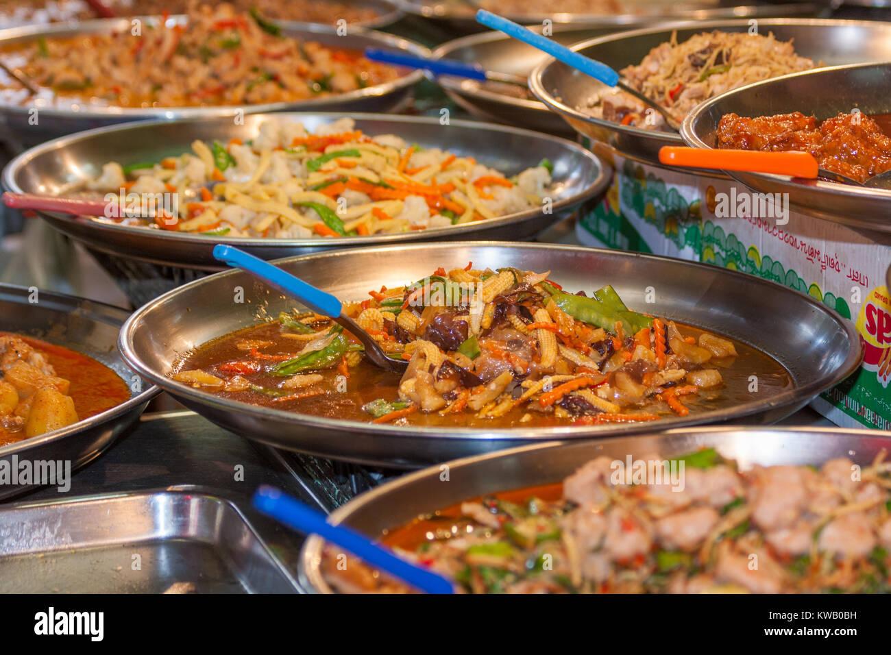 Platters of Thai food on a street food stall, Bangkok, Thailand - Stock Image