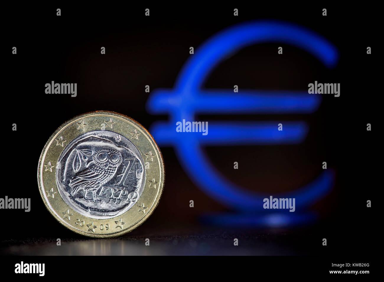Greek euro-coin one and eurosign, Griechische Ein-Euro-M?nze und Eurozeichen, Griechische Ein-Euro-Muenze und Eurozeichen - Stock Image