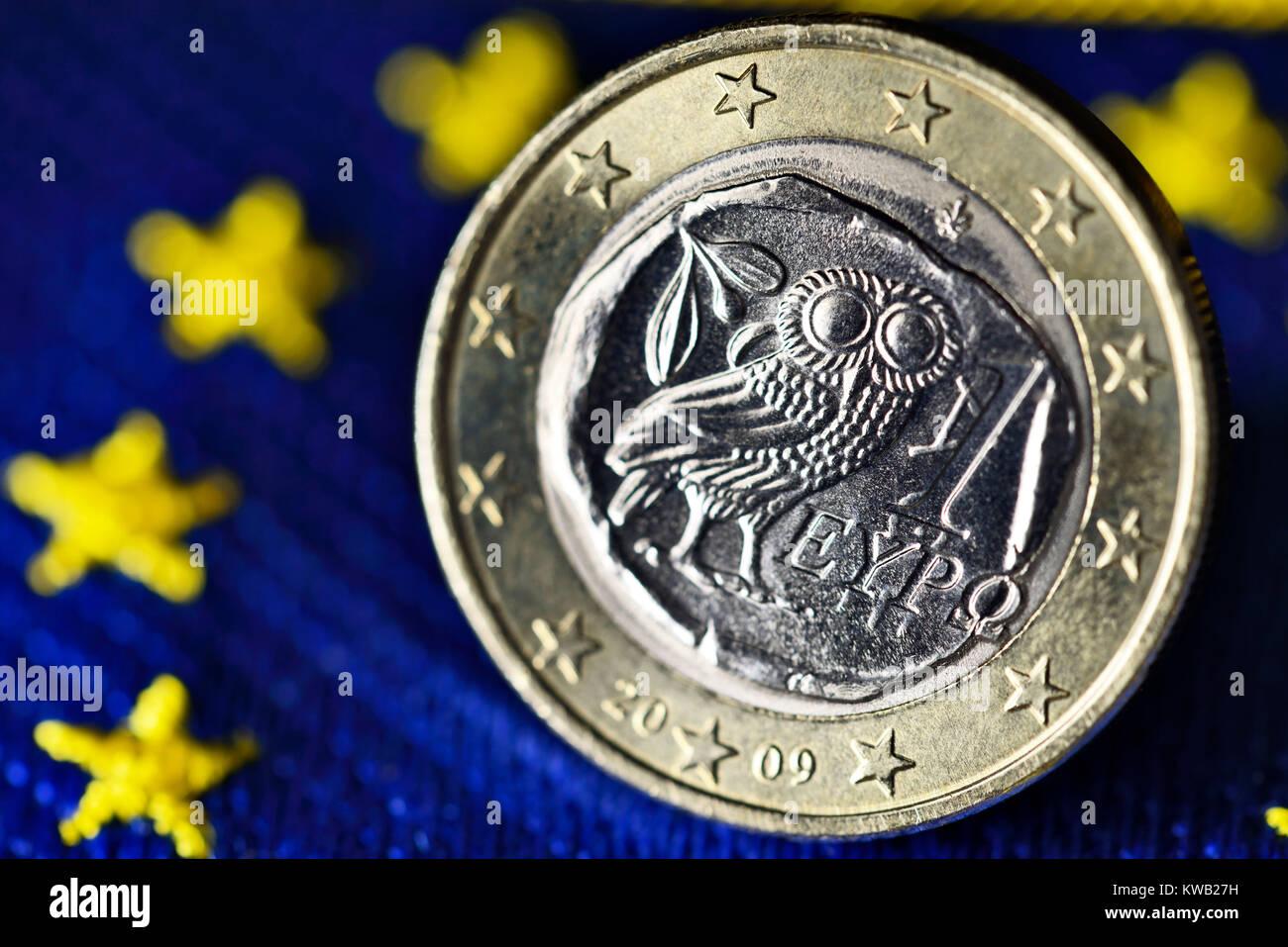 Greek euro-coin one on EU flag, Griechische Ein-Euro-M?nze auf EU-Fahne, Griechische Ein-Euro-Muenze auf EU-Fahne Stock Photo