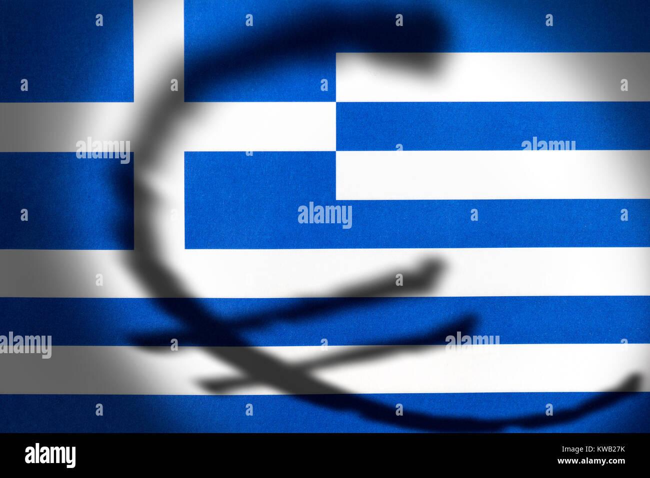 Shades of an eurosign on a Greek flag, symbolic photo eurocrisis, Schatten eines Eurozeichens auf einer griechischen Stock Photo