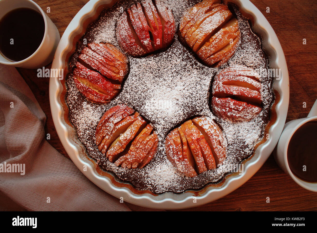 Apple pie, fruit dessert, tart on wooden rustic table. Top view, christmas background - Stock Image