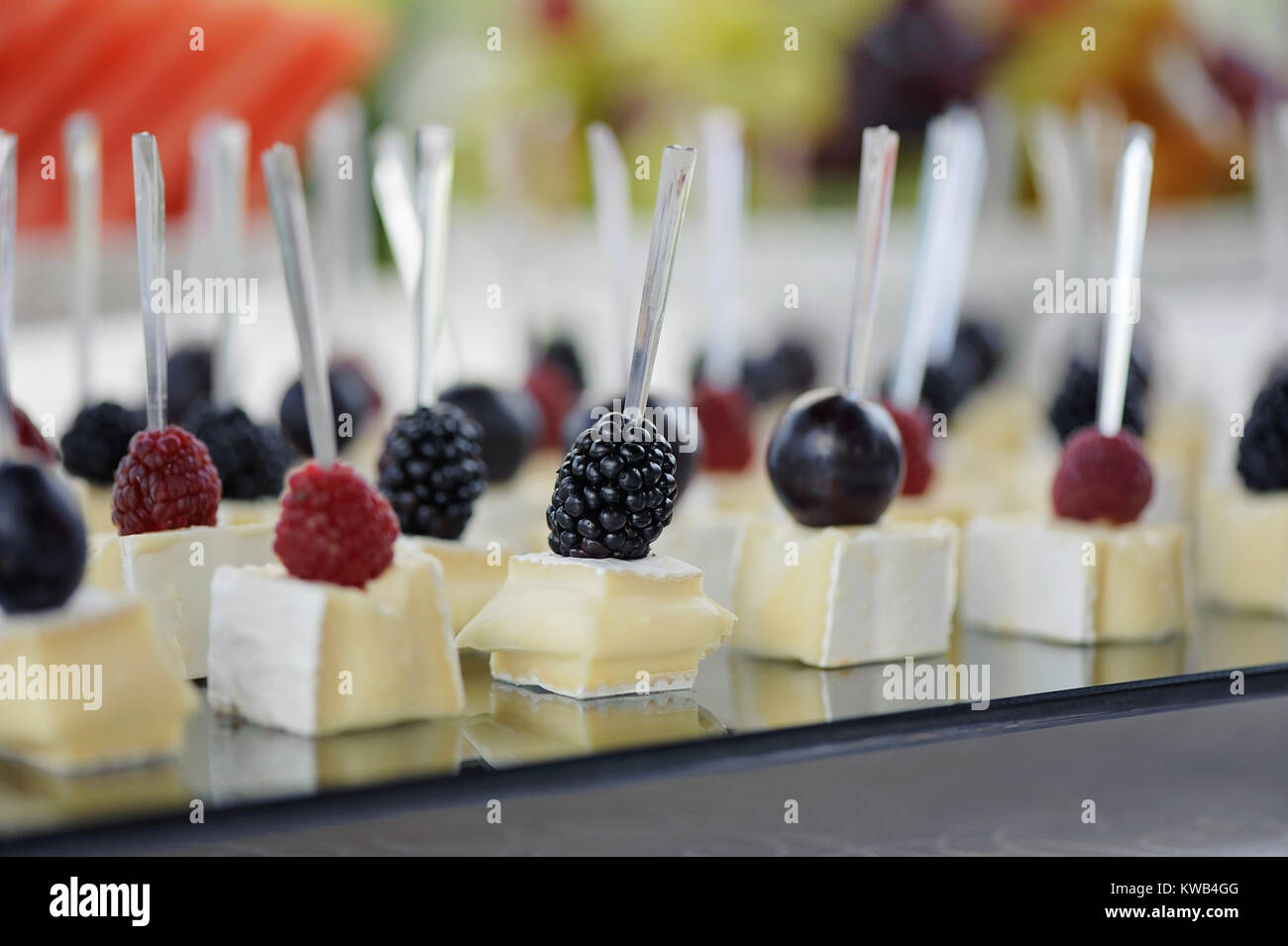 Canapes with cheese and berries selective focus - Stock Image