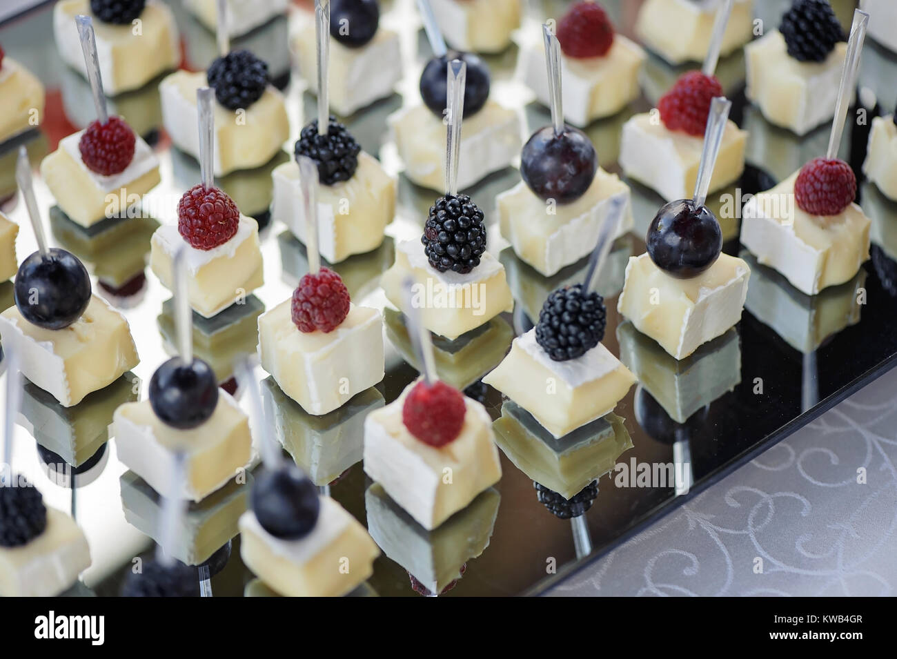 Canapes with cheese and berries closeup - Stock Image