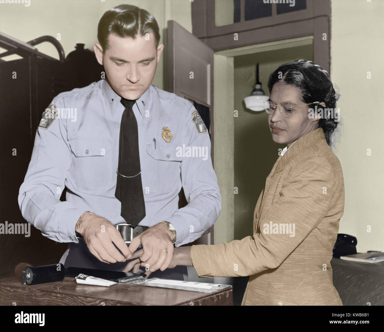 Rosa Parks is finger-printed by Deputy Sheriff D.H. Lackey in Montgomery, Alabama, Feb. 22, 1956. She had been arrested - Stock Image