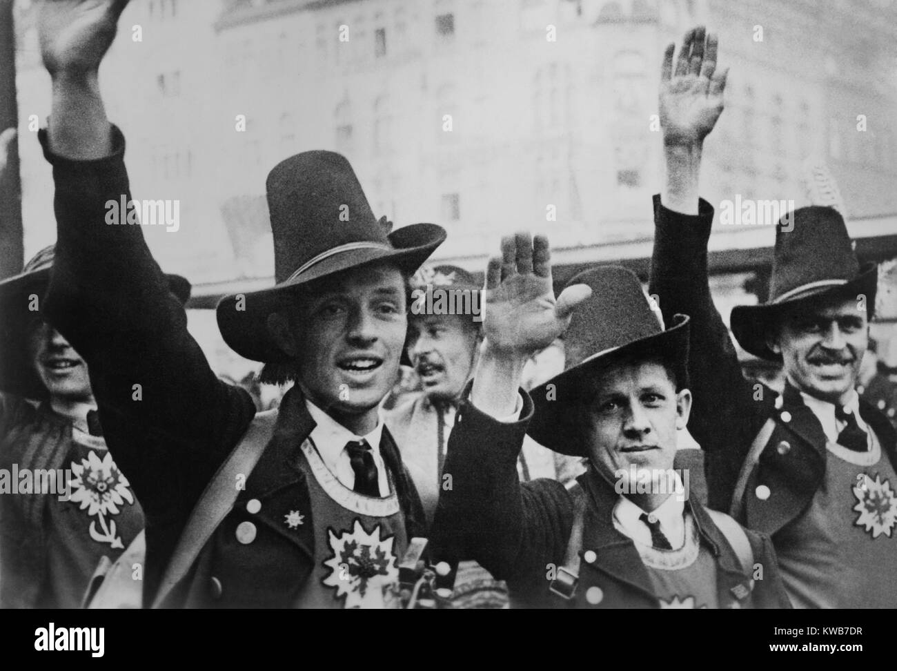 Men in Tyrolean costume celebrate the German annexation of Austria with a Nazi salute. Nazi ideology integrated Stock Photo