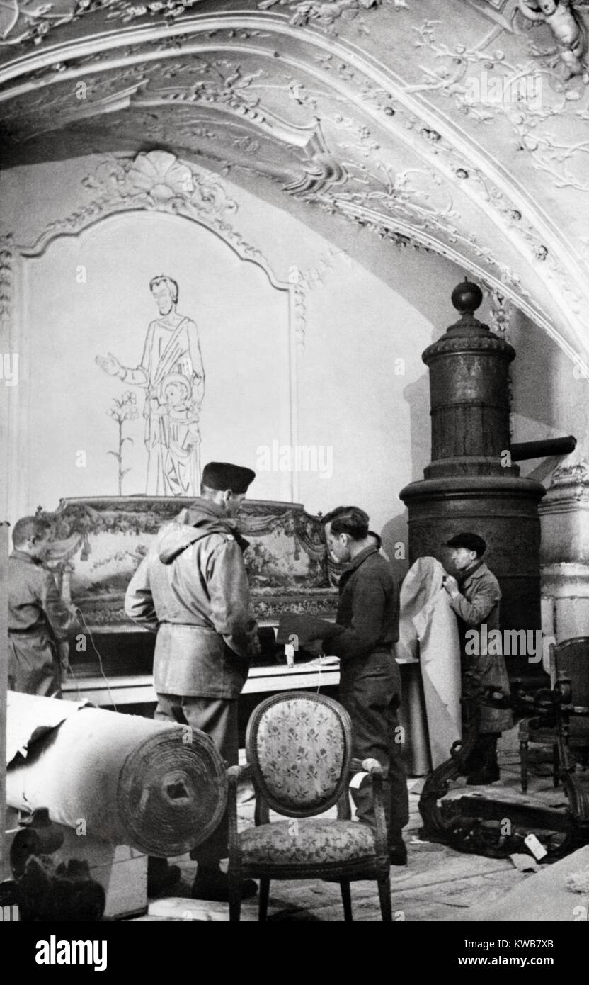 U.S. Army MFAA Section with furniture from Rothschild Paris residences looted by Germans. It was recovered by Monuments, Stock Photo
