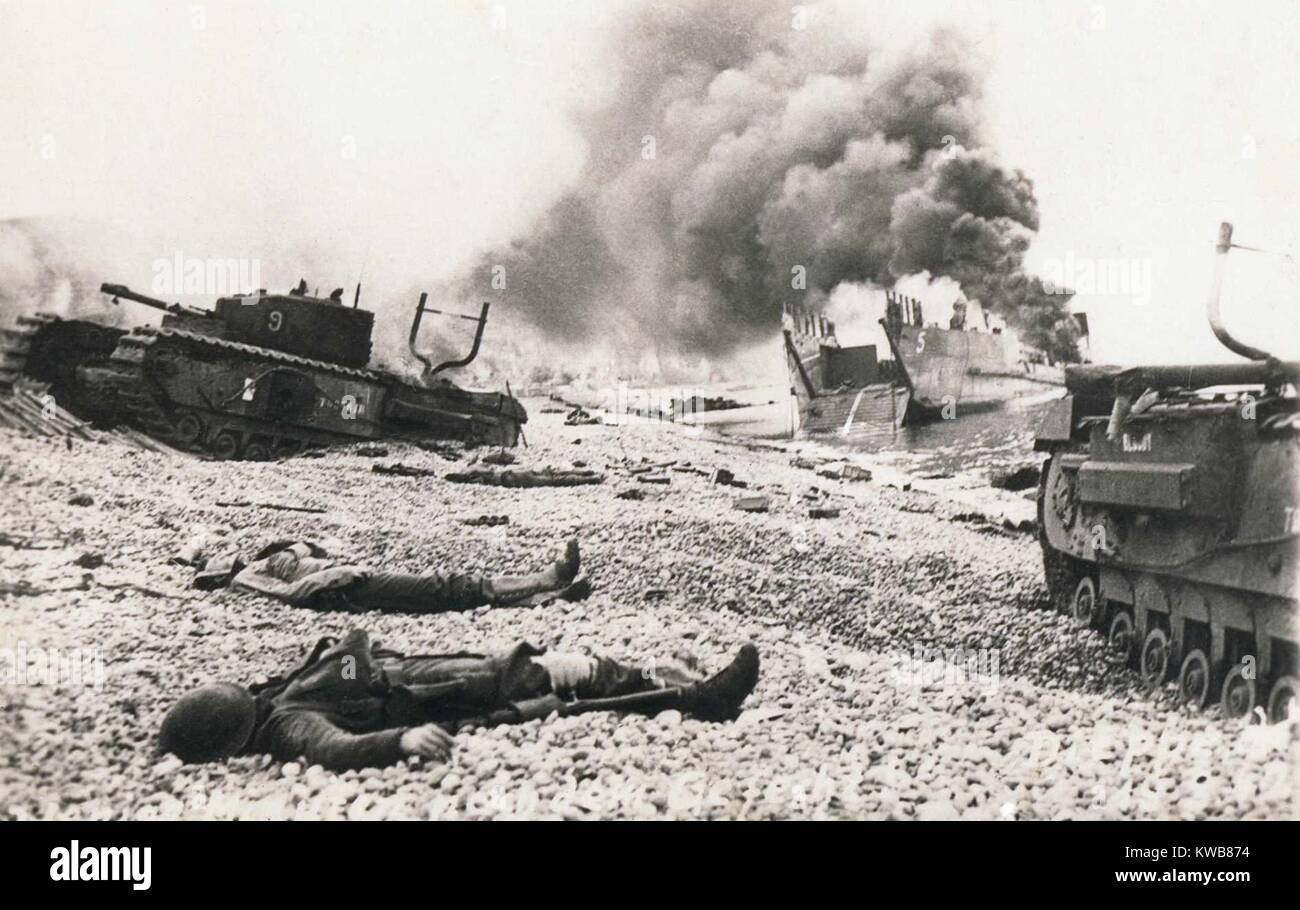 Aftermath of the Dieppe Raid of August 19, 1943. Bodies of Canadian soldiers lying among wrecked landing craft and Stock Photo