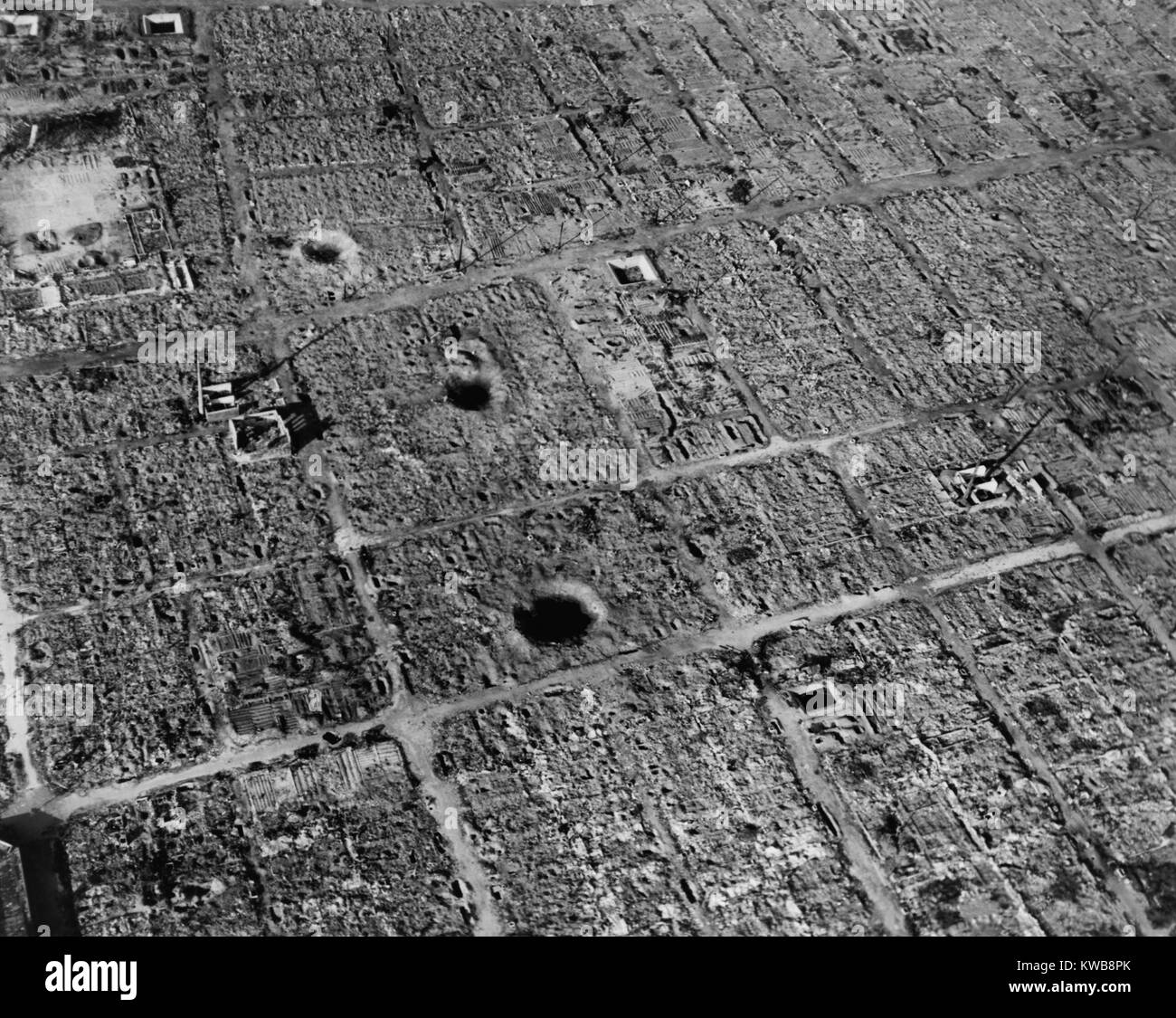 Aerial view of Osaka, Japan, after firebombing by U.S. incendiary bombs. The city suffered three bombing campaigns - Stock Image