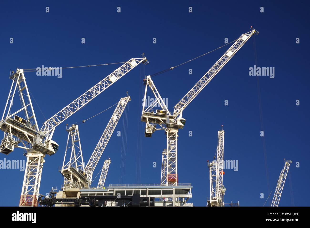 Team of White Tower Cranes against a Brilliant Blue Sky on a Central London Building Site. December, 2017. - Stock Image