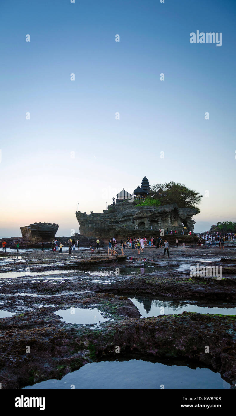 pura Goa Lawah hindu temple sunset backlight silhouette in bali indonesia - Stock Image
