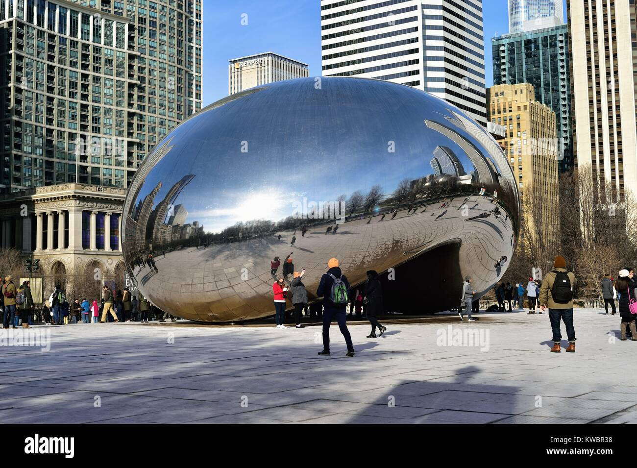 Cloud Gate (also known as The Bean and The Kidney Bean) sculpture in Millennium Park is a tourist attraction even Stock Photo
