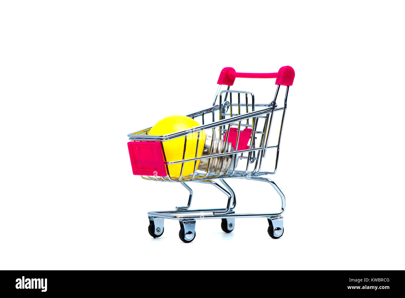 Mini shopping cart or supermarket trolley with yellow tungsten light bulb, isolated on white background, business - Stock Image