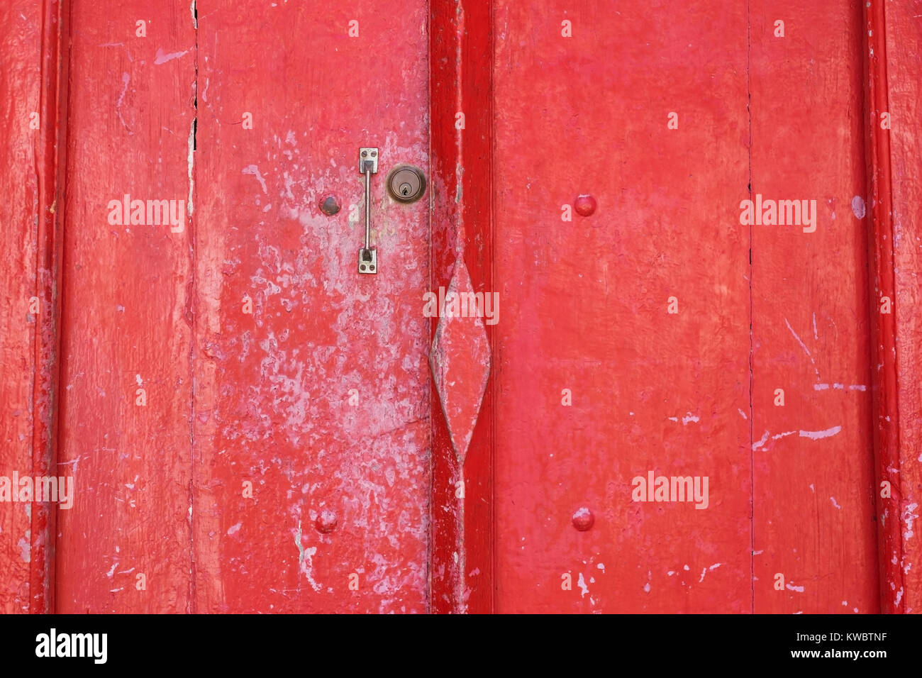 Red wooden antique door with small handle - Stock Image